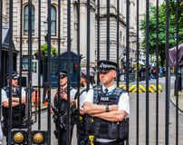Downing Street in London, hdr. LONDON, UK - JUNE 09, 2017: Police and press waiting for Theresa May in front of 10 Downing Street on the day following the Stock Image