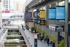 Restaurants and shops at Crossrail Place in Canary Wharf with DL. London, UK - June 25, 2017 - Restaurants and shops at Crossrail Place in Canary Wharf with DLR Royalty Free Stock Photography