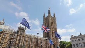London / UK - June 26th 2019 - European Union and Union Jack flags held up outside UK Parliament by Pro-EU anti-Brexit protesters stock video