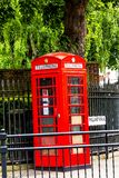 Traditional red English telephone booth at King William Walk street. Greenwich. UK stock photography