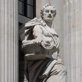 LONDON/UK - JUNI 15: Staty av en köpman utanför gamlan Po Arkivfoto