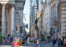 London, UK.  Lloyds bank building. New skyscrapers at the background. City of London browning fast. London, UK - 19 April, 2019: Lloyds bank building. New stock image