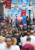 London, UK. Lots of walking people, tourist and Londoners, crossing the Piccadilly circus junction. stock image