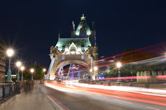 London UK, Majestic Tower Bridge at night with light trails of bus and cars, artistic long exposure night shot Stock Photos