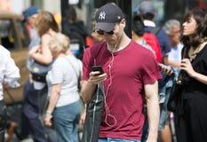 London, UK. man holding mobile phone royalty free stock photo