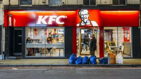 Exterior of a Kentucky Fried Chicken - KFC restaurant at night on Earl`s Court Road, London, England, UK Royalty Free Stock Photography