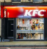 Exterior of a Kentucky Fried Chicken - KFC restaurant at night on Earl`s Court Road, London, England, UK Royalty Free Stock Images