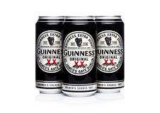 LONDON, UK -MARCH 22, 2018: Aluminium cans of Guinness original beer on white.Guinness beer has been produced since 1759 in Dublin. LONDON, UK -MARCH 22, 2018 Royalty Free Stock Image