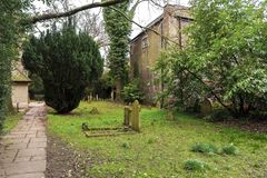 Ancient funeral stones in the yard of St Dunstan`s Church, in Cranford Park