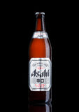 LONDON, UK - MARCH 15, 2017: Bottle of Asahi Lager beer on black background, Made by Asahi Breweries, Ltd in Japan since 1889 Royalty Free Stock Photos