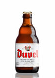 LONDON,UK - MARCH 30, 2017 :  Bottle of Duvel Beer on white. Duvel is a strong golden ale produced by a Flemish family-controlled Stock Image