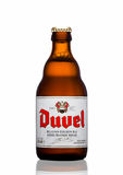 LONDON,UK - MARCH 30, 2017 :  Bottle of Duvel Beer on white. Duvel is a strong golden ale produced by a Flemish family-controlled Stock Images