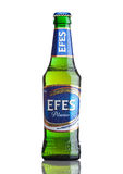 LONDON,UK - MARCH 23, 2017 : Bottle of Efes Pilsner beer on white. Efes Pilsener is the flagship product of this company and the m Stock Images