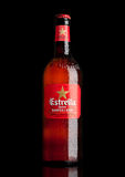 LONDON,UK - MARCH 21, 2017 : Bottle of Estrella Damm beer on black background, Estrella Damm is a pilsner beer, brewed in Barcelon Royalty Free Stock Photography
