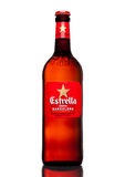 LONDON,UK - MARCH 21, 2017 : Bottle of Estrella Damm beer on white background, Estrella Damm is a pilsner beer, brewed in Barcelon Royalty Free Stock Photos