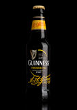 LONDON,UK - MARCH 21, 2017 : Bottle of Guinness foreign extra beer on black.Guinness beer has been produced since 1759 in Dublin, Royalty Free Stock Image