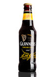 LONDON,UK - MARCH 21, 2017 : Bottle of Guinness foreign extra beer on white.Guinness beer has been produced since 1759 in Dublin, Royalty Free Stock Photos