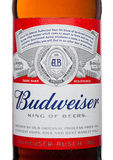 LONDON,UK - MARCH 21, 2017 : Bottle label of Budweiser Beer with new twist off cap on white. An American lager first introduced in Stock Photo