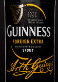 LONDON,UK - MARCH 21, 2017 : Bottle label of Guinness foreign extra beer on black.Guinness beer has been produced since 1759 in Du Royalty Free Stock Photo