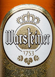 LONDON,UK - MARCH 21, 2017 : Bottle label of Warsteiner Beer on white. Product of Germany`s largest privately owned brewery. LONDON,UK - MARCH 21, 2017 : Bottle royalty free stock images