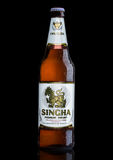 LONDON, UK - MARCH 15, 2017: Bottle of Singha beer on black, Singha beer is most popular in thailand , Rayong , Thailand Stock Image