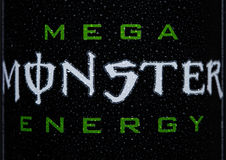 LONDON, UK - MARCH 15, 2017:  A can close up logo of Monster Energy Drink on black. Introduced in 2002 Monster now has over 30 dif Royalty Free Stock Photos