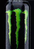 LONDON, UK - MARCH 15, 2017:  A can of Monster Energy Drink on black. Introduced in 2002 Monster now has over 30 different drinks Royalty Free Stock Photos