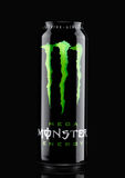 LONDON, UK - MARCH 15, 2017:  A can of Monster Energy Drink on black. Introduced in 2002 Monster now has over 30 different drinks Royalty Free Stock Image