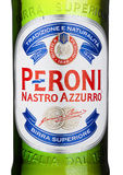 LONDON, UK - MARCH 15, 2017: Cold bottle close up logo of Peroni Beer. Founded n the town of Vigevano, Italy in 1846. LONDON, UK - MARCH 15, 2017: Cold bottle stock image