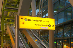 LONDON, UK - MARCH 28, 2015: Departure sing.  Interior of the Heathrow airport Terminal 5. New building Royalty Free Stock Photography