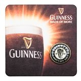 LONDON, UK - MARCH 01, 2018: Guinness draught beer original beermat coaster isolated on white. LONDON, UK - MARCH 01, 2018:Guinness draught beer original stock images