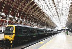 GWR train at Paddington station, one of London`s main transportation hubs. London, UK - March 20 2018: GWR train at Paddington station, one of London`s main royalty free stock image