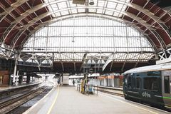 Interior view of Paddington station, one of London`s main transportation hubs. Wide view of the station. London, UK - March 20 2018: Interior view of Paddington royalty free stock photography