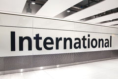 LONDON, UK - MARCH 28, 2015: International arrivals sign. Interior of  Heathrow airport Terminal 5. New building Royalty Free Stock Photos
