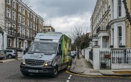 Lorry belonging to the British online supermarket Ocado.com at a posh street in Chelsea, London, UK. London, UK - March 10, 2018: Lorry belonging to the British royalty free stock images