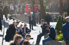 Lots of office people relaxing in the park in the City of London, London Royalty Free Stock Images