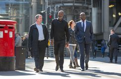 City of London, Walking business people on the street. UK Stock Images