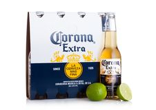 LONDON, UK - MARCH 10, 2018 : Pack of four bottles of Corona extra beer with lime on white.Corona is the most popular imported bee. LONDON, UK - MARCH 10, 2018 royalty free stock photography