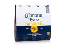 LONDON, UK - MARCH 10, 2018 : Pack of four bottles of Corona extra beer on white.Corona is the most popular imported beer in the U. LONDON, UK - MARCH 10, 2018 stock photos
