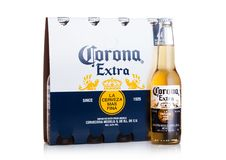 LONDON, UK - MARCH 10, 2018 : Pack of four bottles of Corona extra beer on white.Corona is the most popular imported beer in the U. LONDON, UK - MARCH 10, 2018 stock image