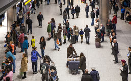 LONDON, UK - MARCH 28, 2015: People waiting for arrivals in Heathrow airport Terminal 5 Royalty Free Stock Photos