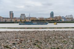 London, UK - 05, March 2019: The Port of London Authority barge used for transportation of bulk materials and waste for recycling stock photo