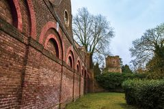 The Stable Block and the tower of the Church of Saint Dunstan`s in Cranford Park