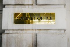 Cabinet Office brass plaque in Whitehall London government office. London, UK - March 7th, 2018: Cabinet Office brass plaque in Whitehall London government stock photography