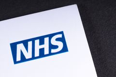 NHS Logo on a Leaflet. LONDON, UK - MARCH 27TH 2018: A close-up of the National Health Service logo on a lealfet, on 27th March 2018.  The NHS is the name used Royalty Free Stock Photo