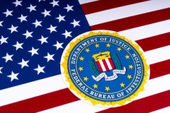 FBI Logo and the USA Flag. LONDON, UK - MARCH 26TH 2018: The seal or symbol of the Federal Bureau of Investigation, portrayed with the US flag, on 26th March Stock Photography