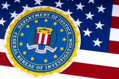 FBI Logo and the USA Flag. LONDON, UK - MARCH 26TH 2018: The seal or symbol of the Federal Bureau of Investigation, portrayed with the US flag, on 26th March Royalty Free Stock Image