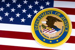 United States Department of Justice. LONDON, UK - MARCH 26TH 2018: The symbol of the United States Department of Justice portrayed with the US flag, on 26th Stock Photos