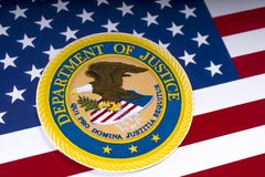 United States Department of Justice. LONDON, UK - MARCH 26TH 2018: The symbol of the United States Department of Justice portrayed with the US flag, on 26th Stock Image