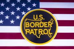 US Border Patrol. LONDON, UK - MARCH 18TH 2018: The symbol of the US Border Patrol pictured over the USA Flag, on 18th March 2018. The USBP is an American royalty free stock photos